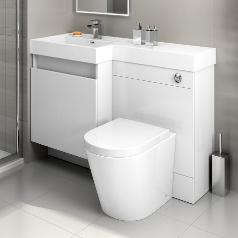 Compact toilet/sink combination in gloss white.