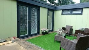 Two bedroom Granny Annexe with anthracite windows and fascia with moorland green leather grain embossed galvanised steel.
