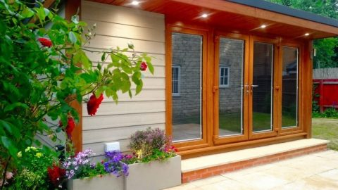 A 4.8m x 3.6m garden room with cedar embossed cladding and oak frames.