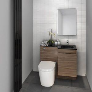 Garden room compact toilet/sink combination in walnut.