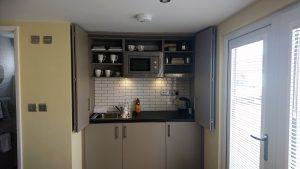 Bespoke garden office hideaway kitchen by The Green Room