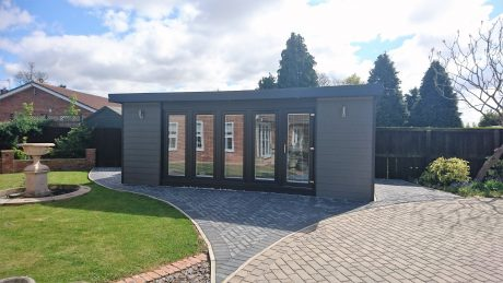 Large Grey Garden Office with Block-paving