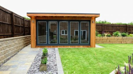 Western Red Cedar Garden Building with Slide and Pivot Aluminium Doors by The Green Room