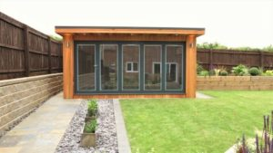Western Red Cedar Garden Building with Slide and Pivot Aluminium Doors